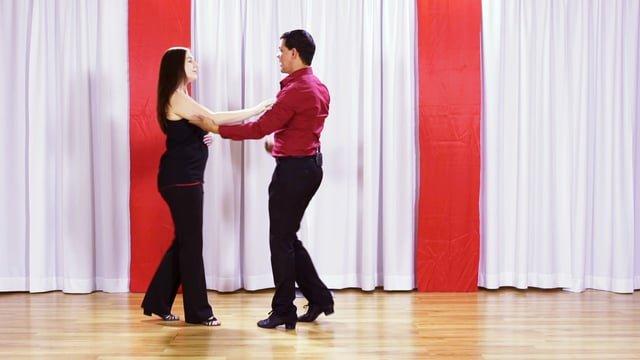 Inside turn from handshake hold